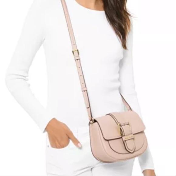 Michael Kors Handbags - NWT Michael Kors Light Pink Buckle Crossbody